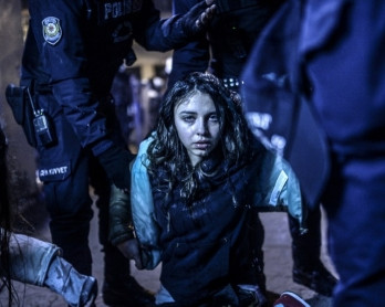 A young girl wounded during clashes between riot police and protestors in Istanbul on March 12, 2014