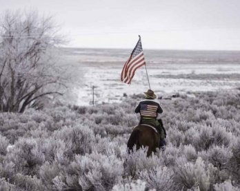 Occupier Duane Ehmer rides his horse Hellboy on January 7, 2016. (AFP/Rob Kerr)