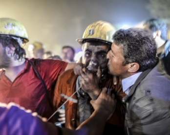 A miner caught in the May 13, 2014 blast in Soma, western Turkey, is reunited with his father