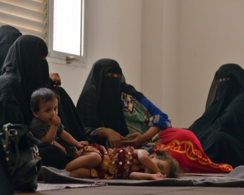 Yemeni women sit with their children at a UNHCR facility at Obock in Djibouti on April 12, 2015